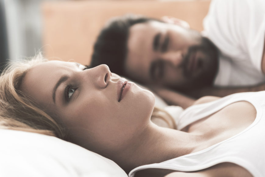 Woman having trouble sleeping due to parasomnias