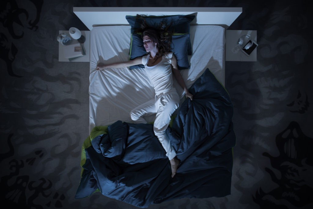 Woman hallucinating in her sleep