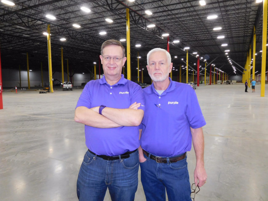 Purple founders, Tony and Terry Pearce in their warehouse.