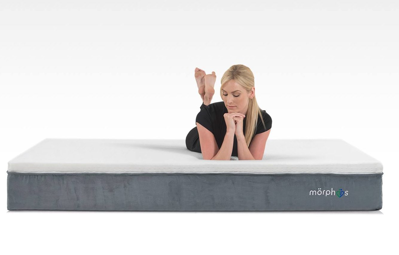 Morphiis mattress in a studio with a woman laying on it