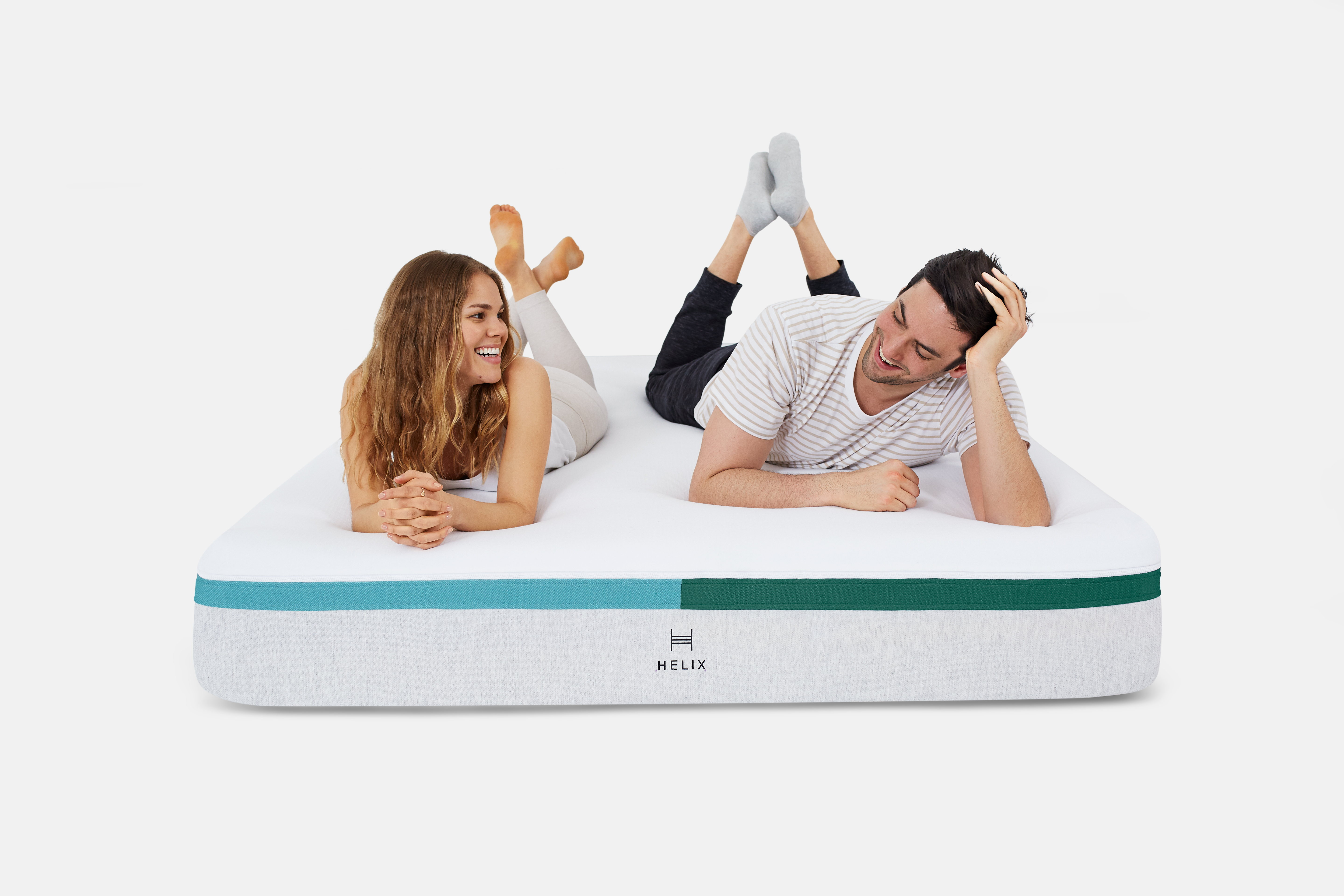 Couple laying on the dual-sided mattress