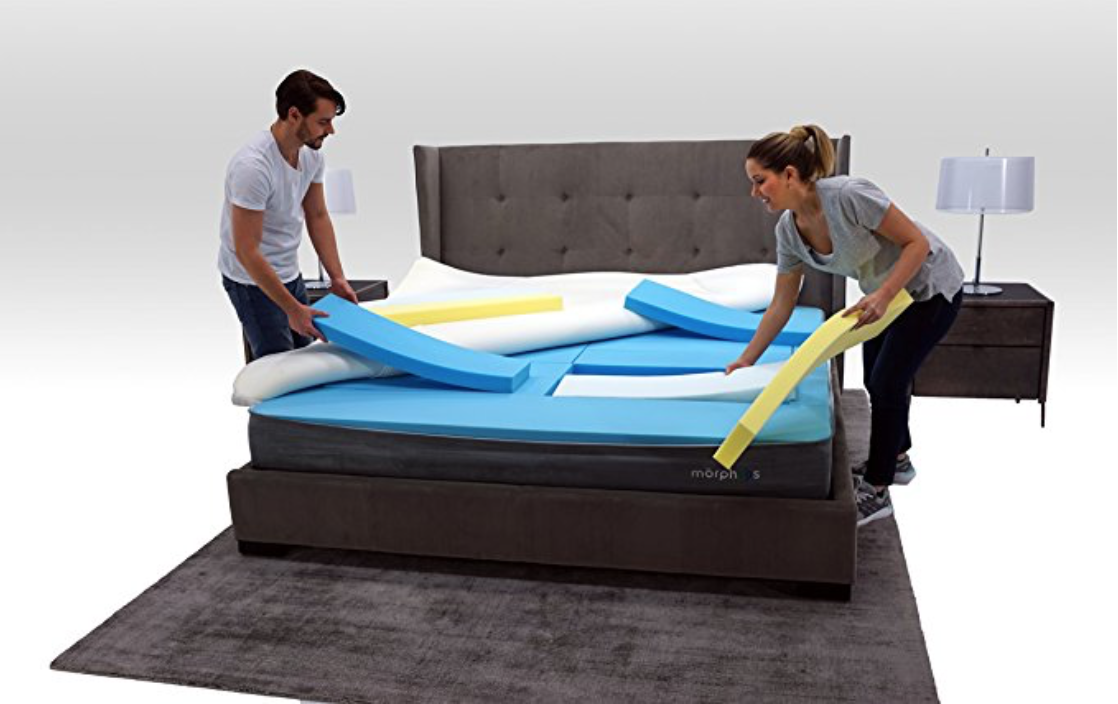 A male and female customizing the firmness of their Morphiis mattress