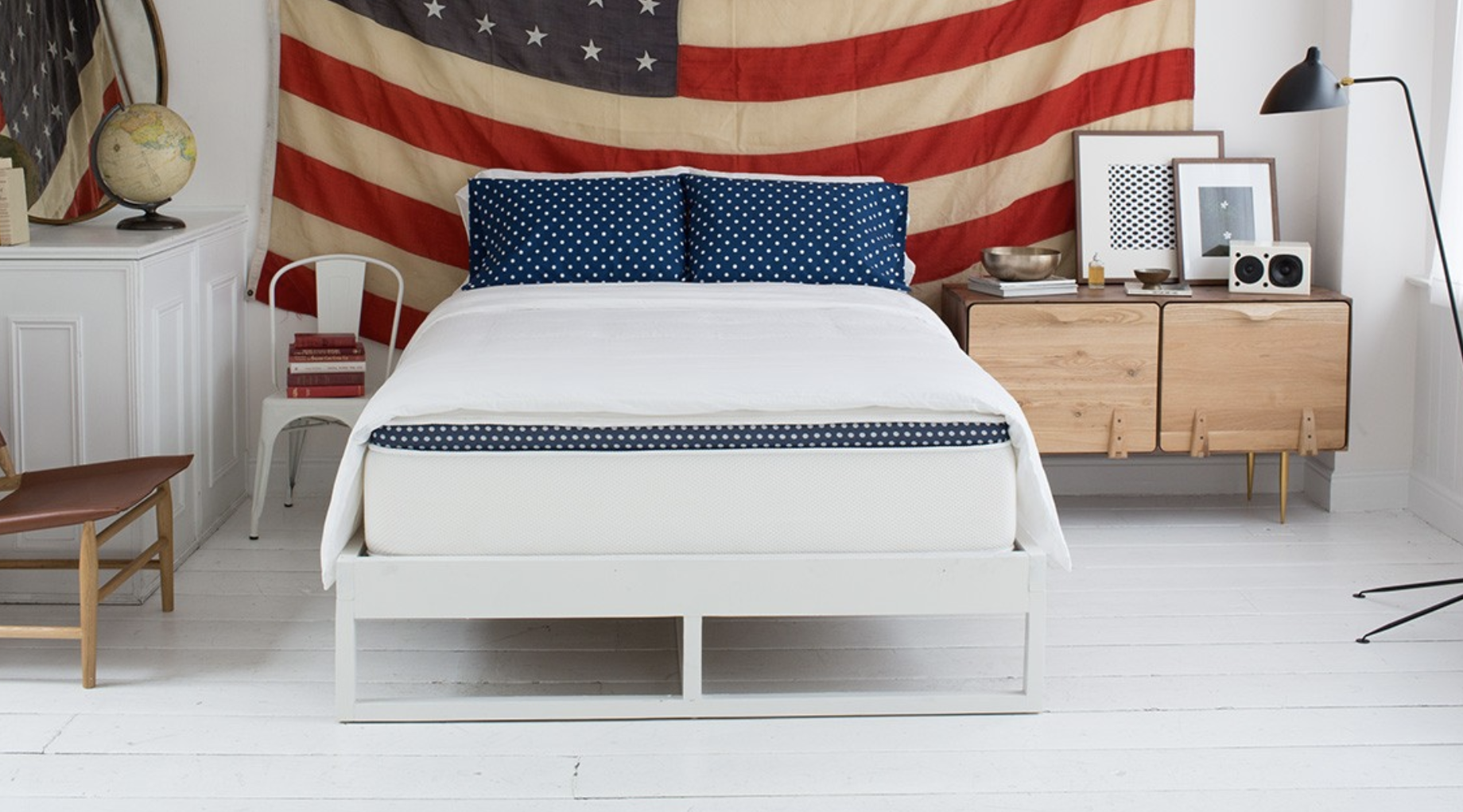 WinkBed Plus in a bedroom with an American flag hanging on the wall