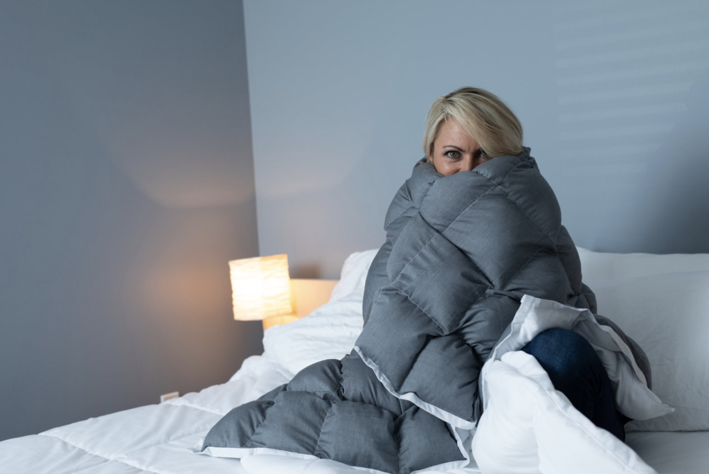 Woman wrapped in SensaCalm Weighted Blanket 2