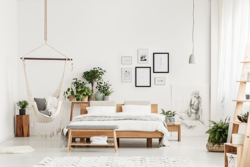 Spacious white bedroom with plants