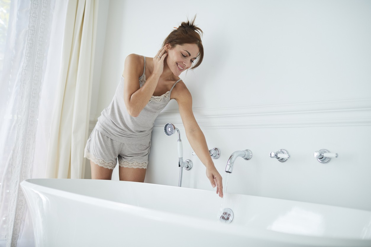 Woman relaxing a luxury bathroom. Lifestyle shot in real location, Spain. Polish model.