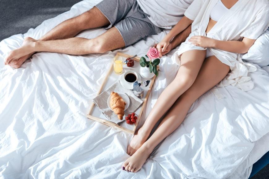 couple in love having breakfast in bed