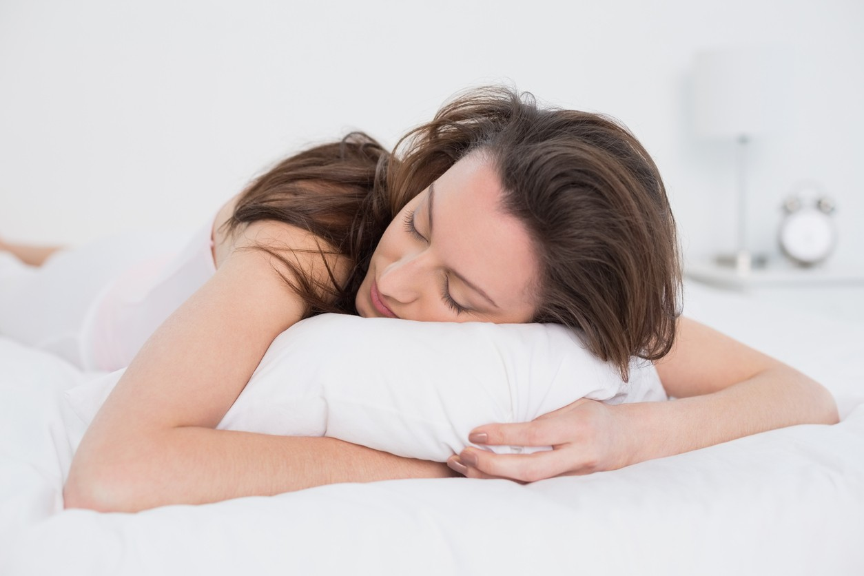 Close up of pretty young woman sleeping with her head on the pillow