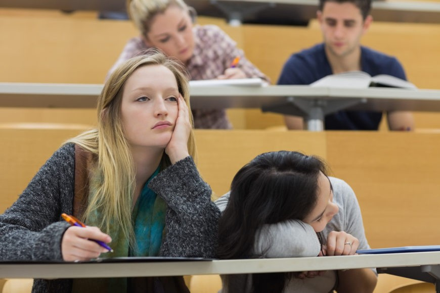 College student falling asleep in class