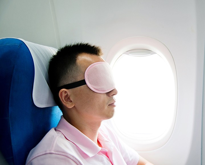 Using a sleeping mask on a plane