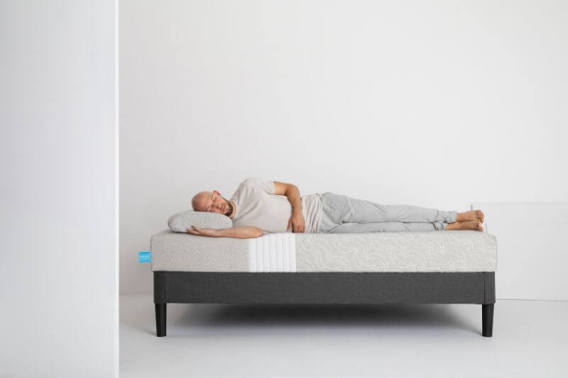 man laying on the Level Sleep mattress on his side