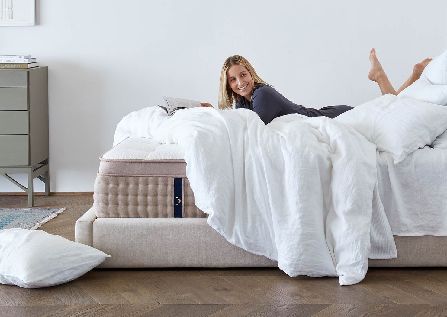 Woman laying on a DreamCloud mattress