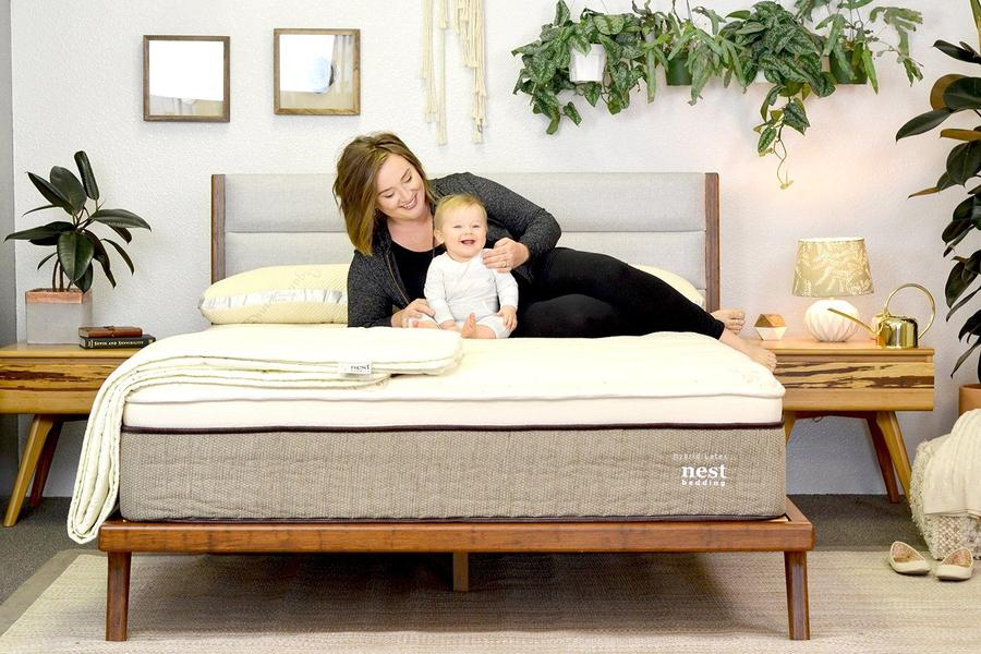 Nest Bedding's natural hybrid latex mattress in a room with mother and son reading