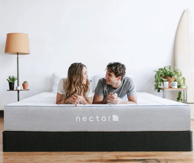 Couple resting on a Nectar mattress