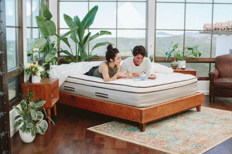 couple on a bed in a bedroom