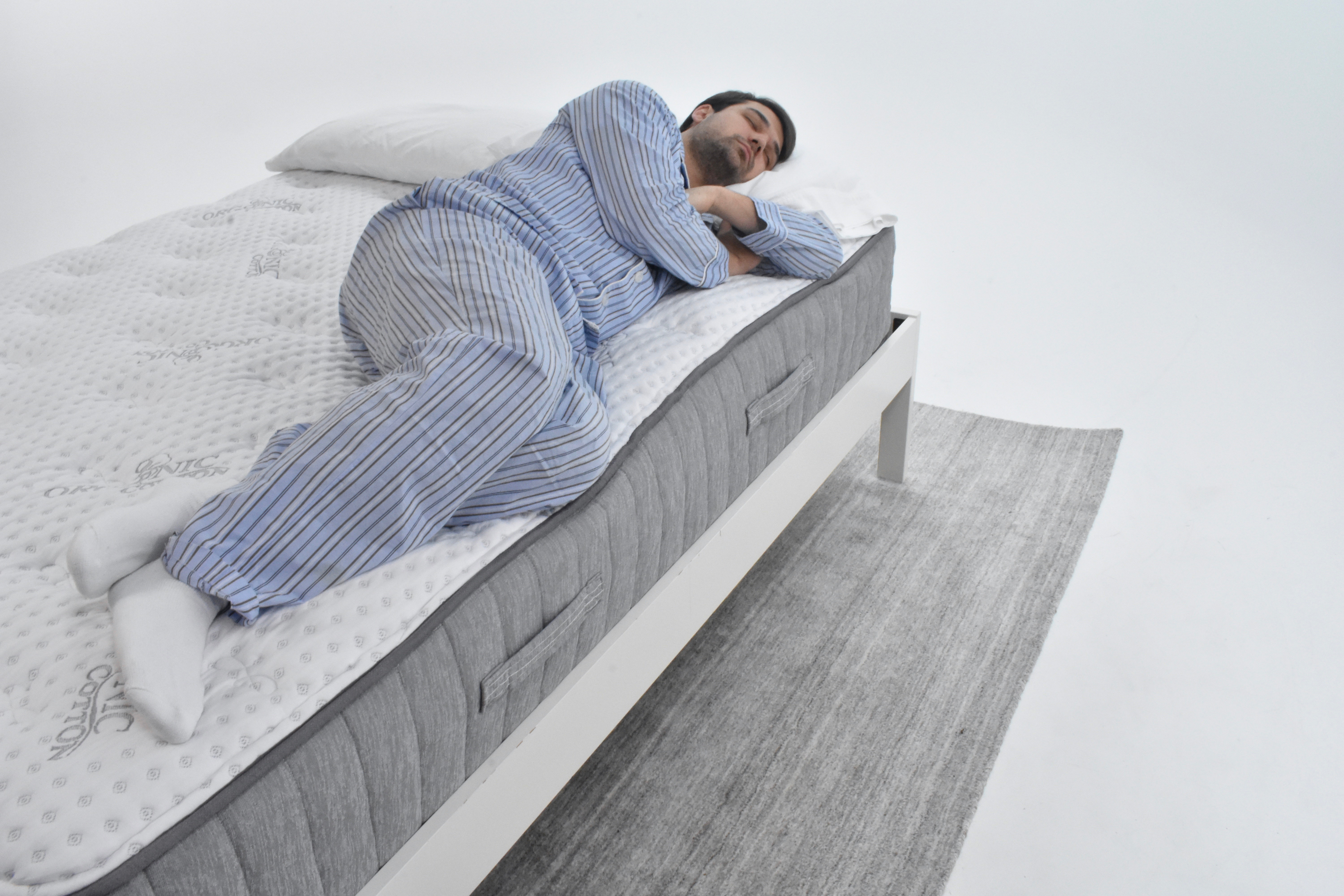 Man laying on the edge of the Bloom Hybrid testing the edge support