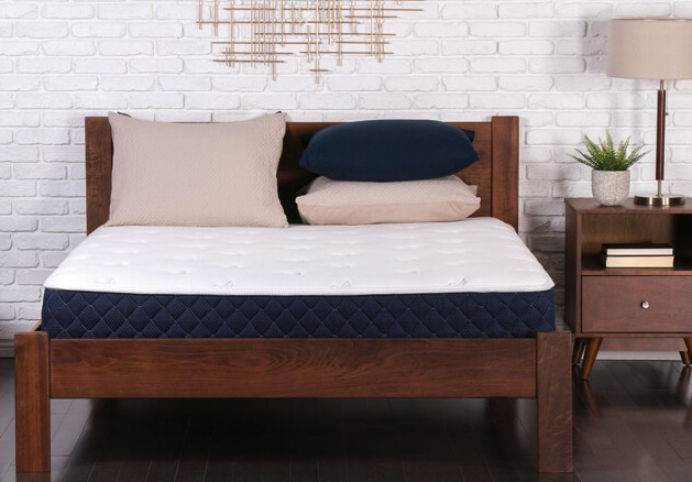 Bowery hybrid mattress in a bedroom with pillows