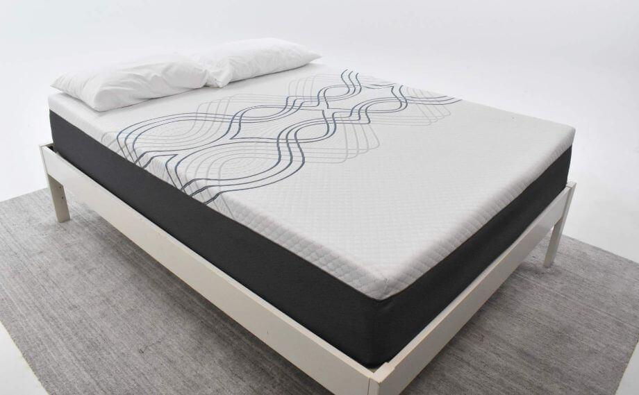 eluxury hybrid mattress on a bed frame