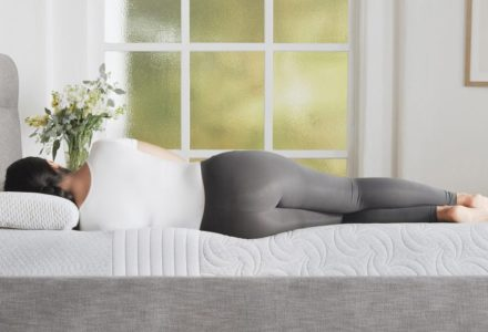 woman laying on Level Sleep mattress showing spine alignment