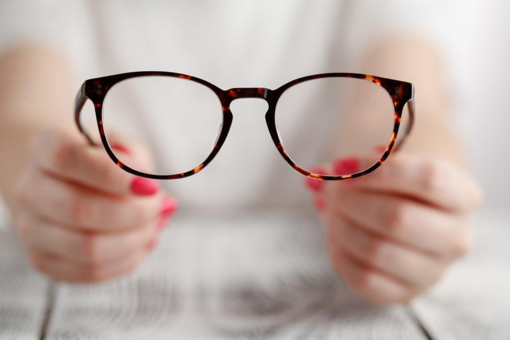 Hand holding glasses