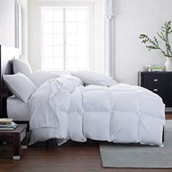 side view of bed in bedroom with plush comforter