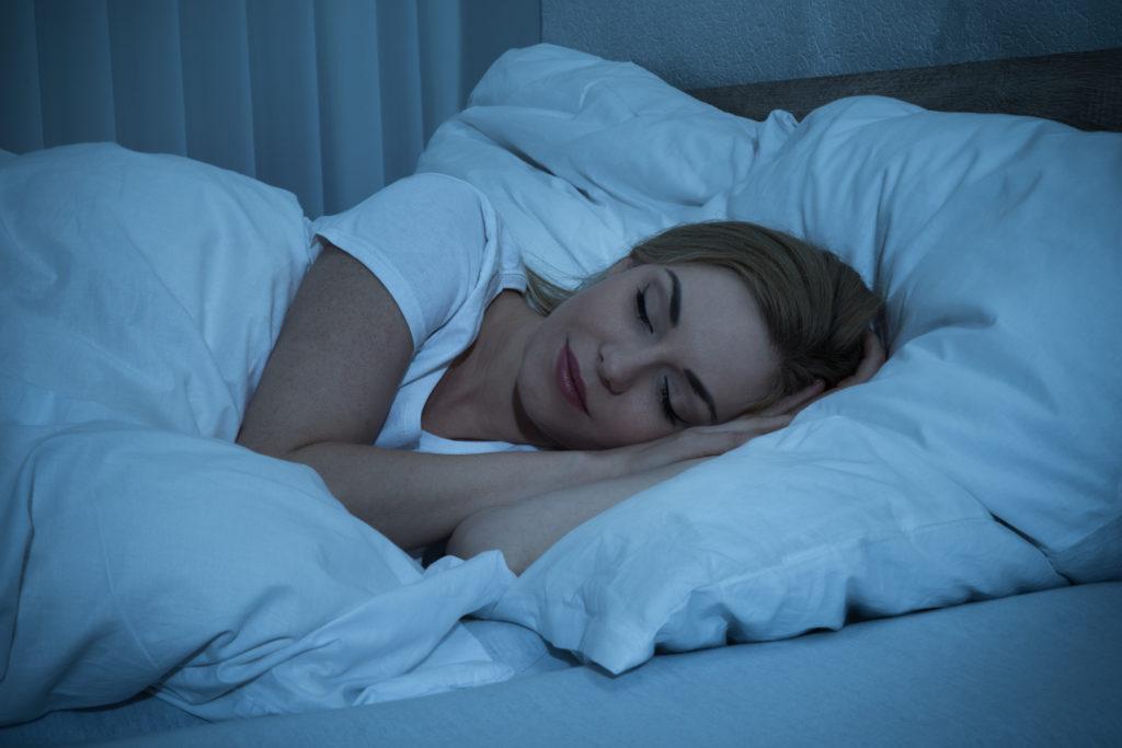 woman sleeping bed e1596117677531