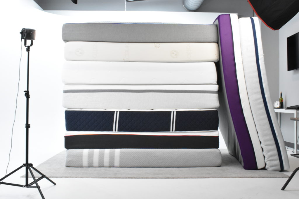 Stack on online mattresses piled on top of each other