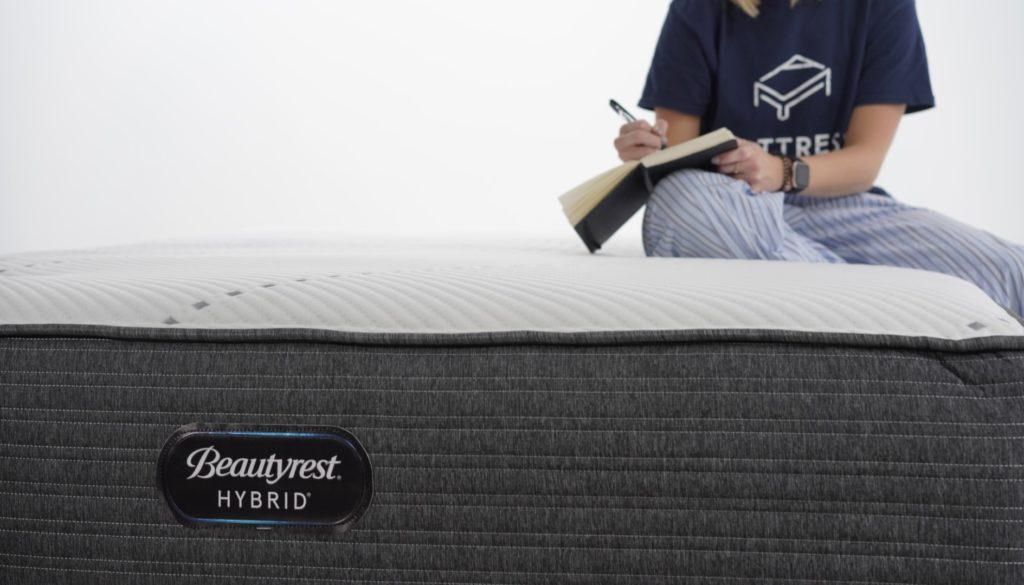 Woman writing on the Beautyrest Hybrid