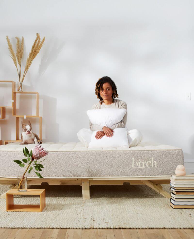woman sitting on the Birch mattress