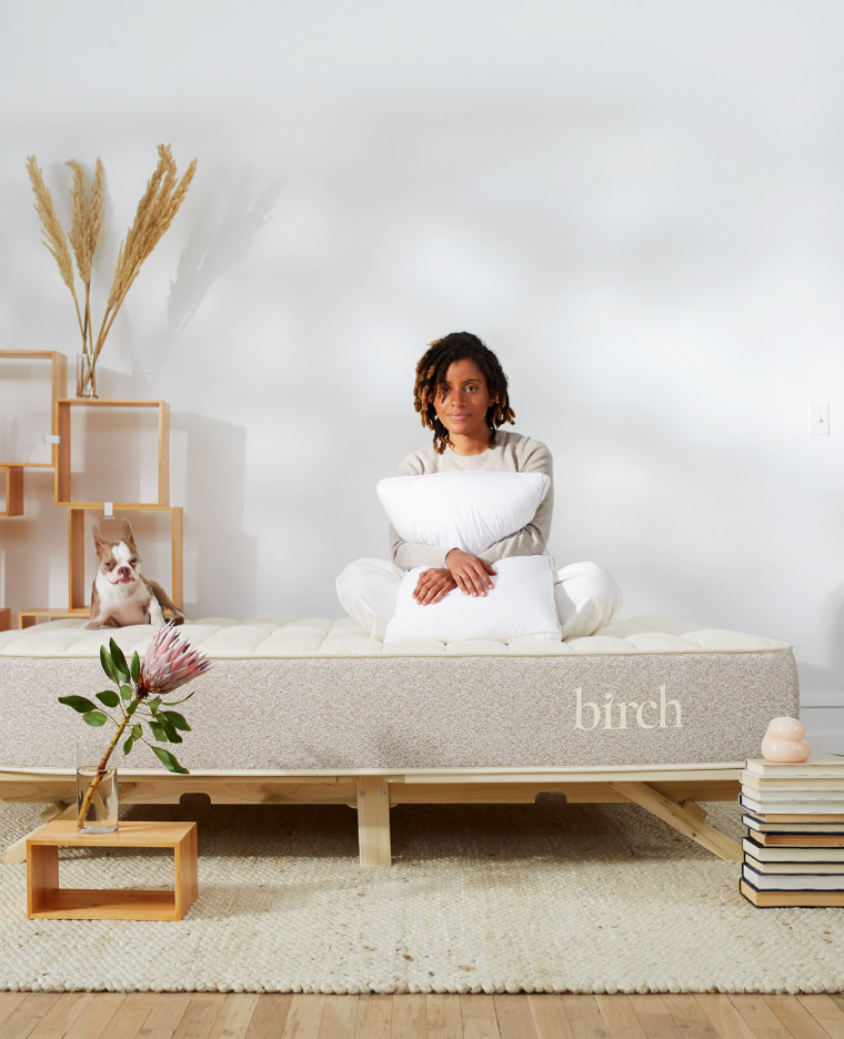 woman on birch mattress in bedroom