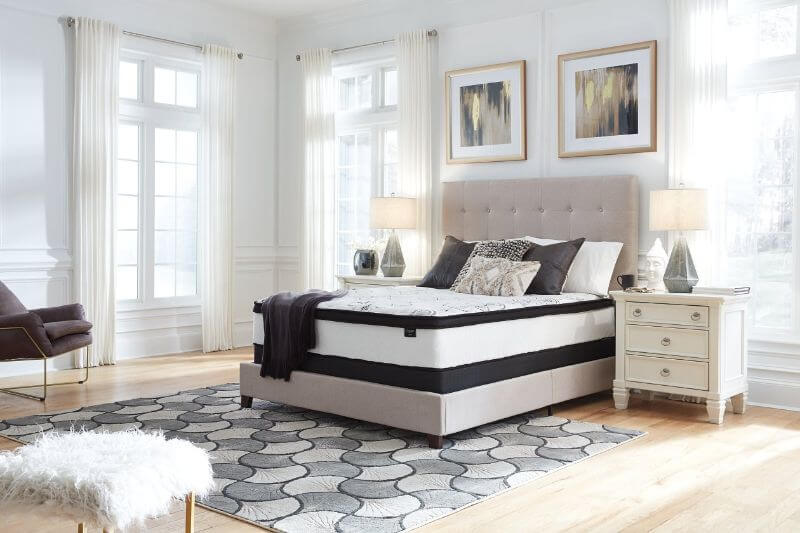 Ashley Furniture Chime Hybrid mattress in a bedroom